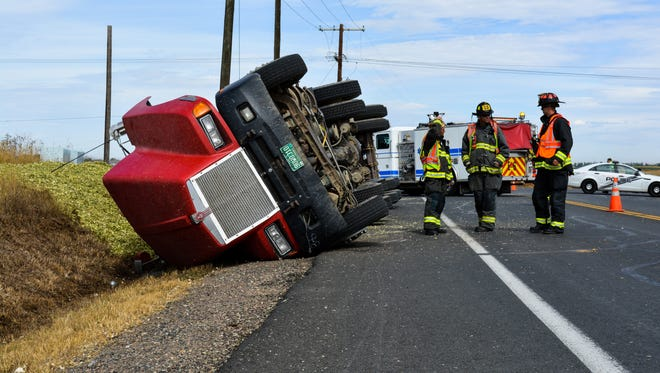 An 18-wheeler flipped onto its side Thursday in northeast Fort Collins, spilling its load of silage.