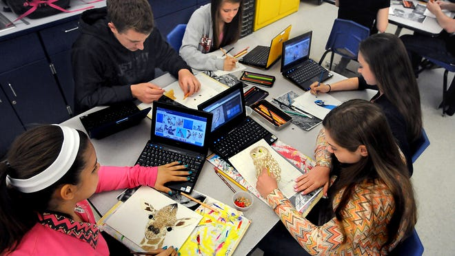 Beacon High School students, clockwise from lower left, Lauren Mesorana, 14, Jason Antalek, 16, Sydney Dexter, 14, Amber Butler, 14, and Jessica Musacchio, 14, use the aid of a computer to draw animals in Claudine Farley–Davis' studio art class.