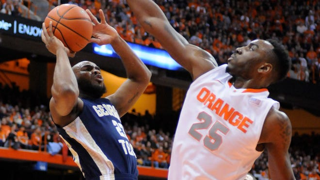 Georgia Tech Yellow Jackets guard Trae Golden takes a shot with Syracuse Orange forward Rakeem Christmas defending at the Carrier Dome.