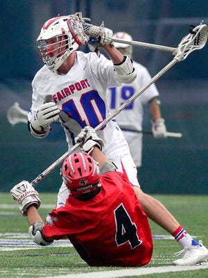 Fairport's T.J. Hendricks, top, gets by Penfield's Anthony DiPrima during a Class A semifinal played at Webster Thomas High School on Friday, May 26, 2017.  No. 2 Fairport advanced to the Class A final with a 13-9 win over No. 3 Penfield.