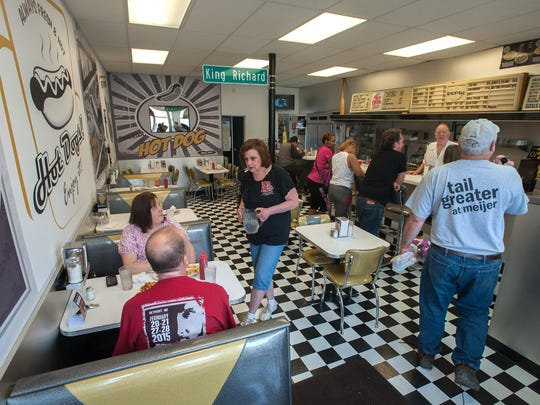 """Red hots owner Carol Harlan chats with customers in May. After Monday's announcement, Harlan said, """"half a dozen people came in and said all that talk about hot dogs made them want a Coney."""""""