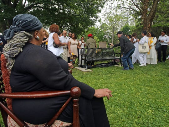 Toni Morrison, left, watches the unveiling of Nyack's Bench by the Road in Nyack May 18, 2015. The bench commemorates the life of abolitionist Cynthia Hesdra, a former slave who became an entrepreneur. The Toni Morrison Society created the bench project to create spaces to summon the history of slavery of Africans in the United States and the Caribbean, and to reflect on the absence of their stories in our historic teachings.
