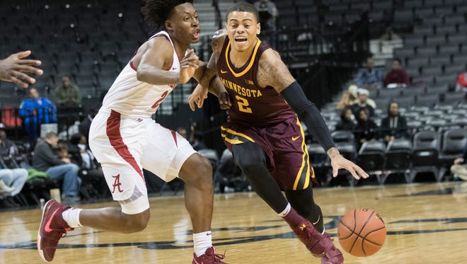 Minnesota guard Nate Mason, right, drives to the basket against Alabama guard Collin Sexton during the second half of an NCAA college basketball game, Saturday, Nov. 25, 2017, in New York. Minnesota won 89-84.(AP Photo/Mary Altaffer)