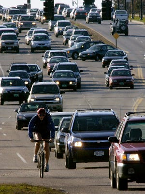 Under a law going into effect Friday, motorists should give cyclists 4 feet of room when passing.