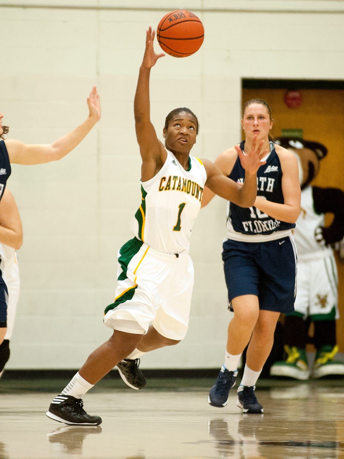 Catamounts guard Kylie Butler, center, grabs the loose