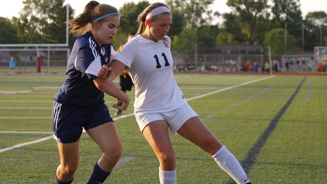 Lansing Christian's Kasey Jamieson, right, is one of the Lansing area's top returning players in 2017.