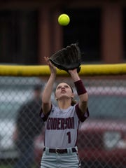 Henderson County's Kaytlan Kemp hauls in a Gibson Southern fly ball during their game at the Henderson County Softball Field Monday evening.