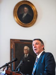 Gov. Phil Scott answers a question about the proposed