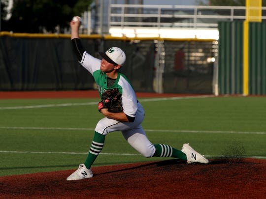 Iowa Park's Braxton Briones pitches against Godley in Game 3 of the Region I-4A finals Friday, June 1, 2018, at Northwest High School in Justin.