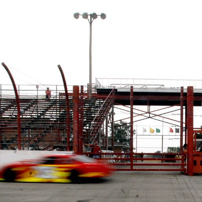 The late model stock car of David Stremme flies past the grandstand at Winchester Speedway during a test session in this file photo from September 2008.