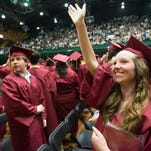 Erin Lebeda waves to the crowd after she crossed the stage at the Moby Center during the Rocky Mountain High School graduation ceremony Saturday, May 23, 2015 in Fort Collins, Co.
