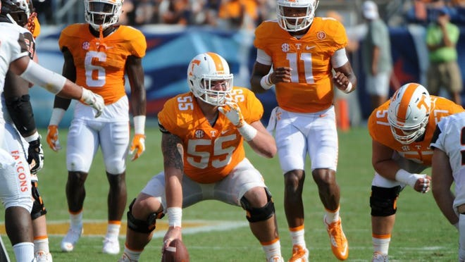 Tennessee offensive lineman Coleman Thomas (55) gets set for quarterback Joshua Dobbs (11) during the first half against Bowling Green in Nissan Stadium in Nashville Saturday, Sep. 5, 2015. MICHAEL PATRICK/NEWS SENTINEL