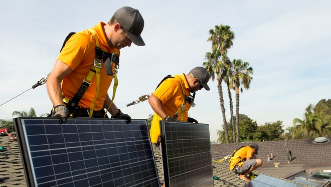 Vivint Solar employees install solar panels in California. Few green jobs have followed millions of dollars in investment.