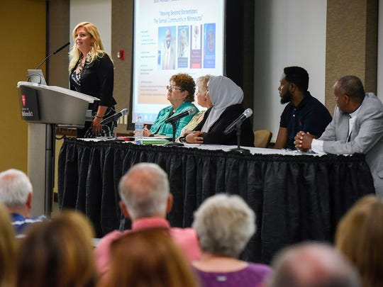 Tammy Wilson, principal at Discovery Community School, speaks during a panel discussion at the Peace Studies Conference Tuesday, Sept. 12, at the College of St. Benedict.