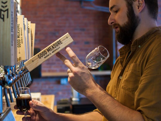 Brewer Andrew Leichthammer pulls a sample of Shapes