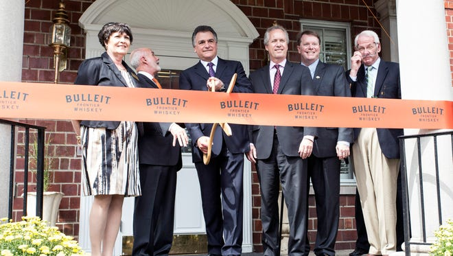 Dignitaries including Tom Bulleit, Larry Schwartz, and Mayor Greg Fischer cut the ribbon to officially open the new Bulleit Bourbon Distillery off Dixie Highway on Monday afternoon. 9/15/14