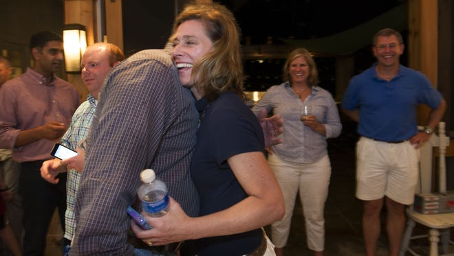 Metro School Board Candidate Mary Pierce hugs Mayor Karl Dean, who popped into her campaign party Thursday, Aug. 7, 2014 in Nashville, Tenn.