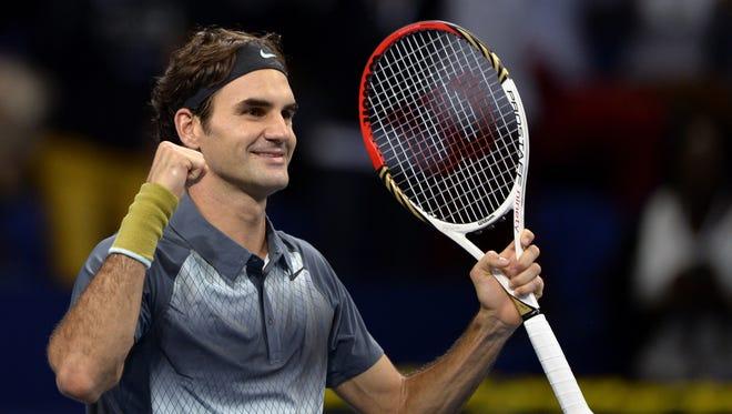 Roger Federer celebrates his semifinal win over Vasek Pospisil.