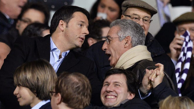 Florence mayor Matteo Renzi, left, looks at someone in the audience during an Italian Serie A football match between Fiorentina and Inter Milan on Feb. 15.