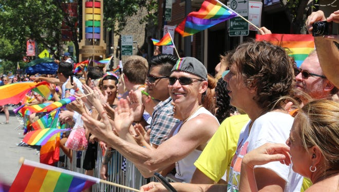 Spectators line the streets during Chicago's 4th annual Pride Parade on June 29.