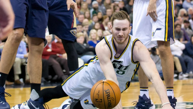 Utah Jazz forward Gordon Hayward (20) loses control of the ball as he falls to the floor during the second half against the New Orleans Pelicans at Vivint Smart Home Arena on Dec. 16, 2015.