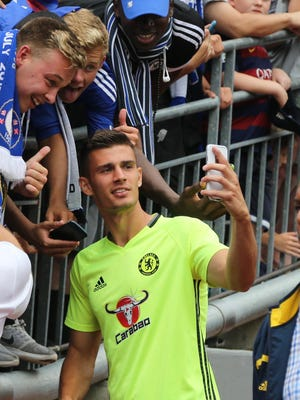 Chelsea FC defender Matt Miazga takes a selfie with fans Saturday afternoon at the Big House before the International Champions Cup match won by Read Madrid, 3-2. The 21-year-old did not see the pitch.