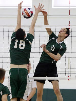 Old Bridge High School takes onEAst Brunswick High School in a boys varsity volleyball game in East Brunswick on Tuesday April 26, 2016.St Joseph's # 21 (right) Dan Vajtay gets the ball past East BRunswick's # 18 (left) Yoni Auerbach.