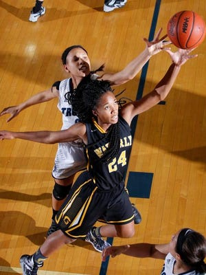 Waverly's Shadaira McCarty (24) and East Lansing's Evelyn Taylor reach for a rebound Friday, Dec. 4, 2015, in East Lansing, Mich. Waverly won 50-27.