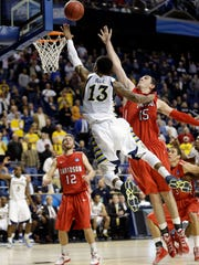 Marquette's Vander Blue scores the game-winning basket against Davidson's Jake Cohen in the final seconds of a second-round NCAA Tournament game.