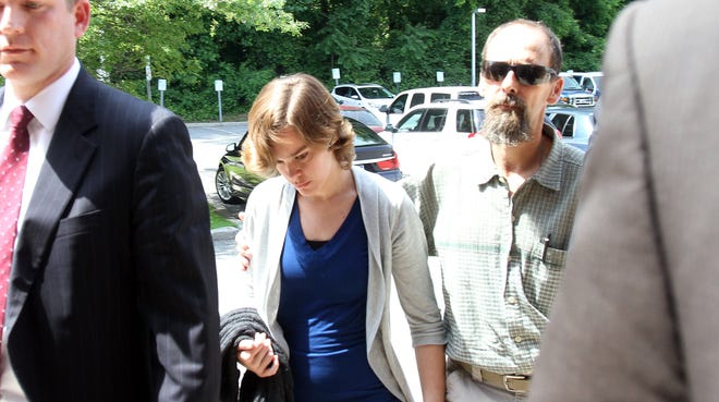 Lacey Spears is accompanied by her father, Terry, as she is led into a back door at Westchester County Police headquarters in Hawthorne on June 17, 2014.