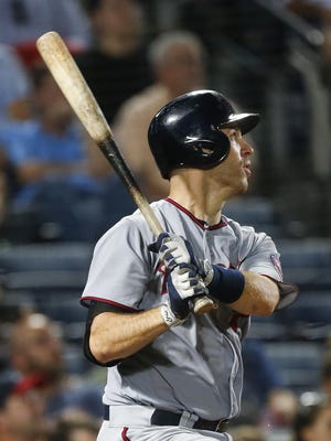 The Minnesota Twins' Joe Mauer watches his solo home run during the eighth inning Tuesday against the Atlanta Braves in Atlanta.