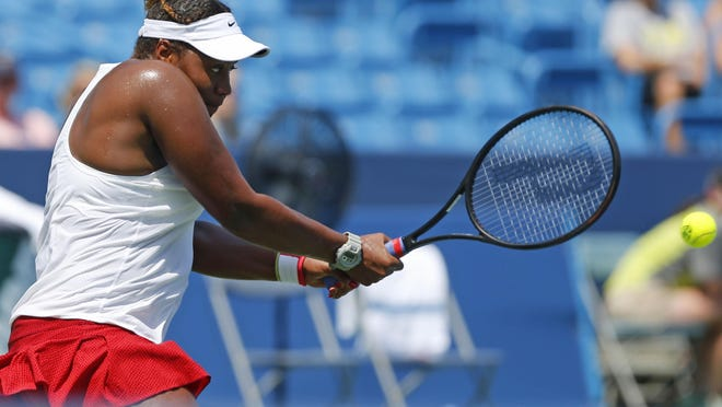 Taylor Townsend returns a shot against Anna Karolina Schmiedlova during qualifying at the Western & Southern Open Saturday. Townsend lost but likes where her game is.