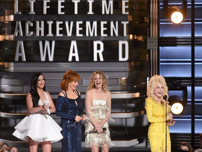 Dolly Parton accepts the Willie Nelson Lifetime Achievement