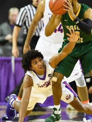 Former Reitz Panther Dru Smith goes for a steal against Norfolk State's Jonathan Wade as the University of Evansville Purple Aces play the Norfolk State Spartans at the Ford Center in Evansville Wednesday, December 14, 2016.