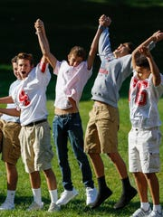 Wilson Junior High ninth-graders do the wave during team-building games on the first day of school Sep. 5, 2017, in Manitowoc.