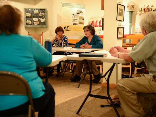 Marilyn Bryant, left, and  Kathleen Baker attend a memoir-writing course taught by Rae Tyson.