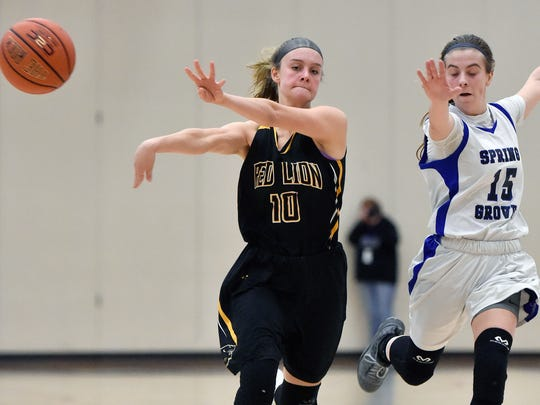 Red Lion's Alleney Klunk passes the ball against Spring