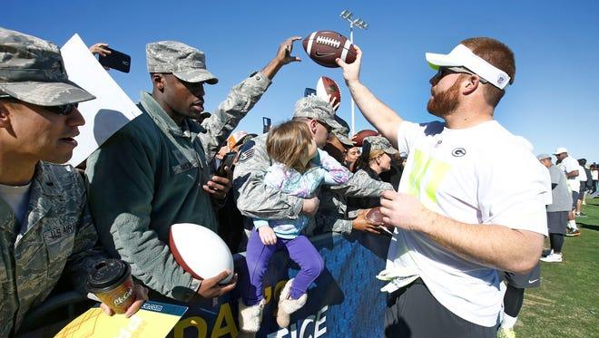 John Kuhn signs autographs during NFL Pro Bowl team practice at Luke Air Force Base on Thursday, Jan. 22 2015 in Glendale.