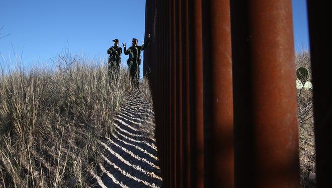 U.S. Border Patrol agents next to the U.S.-Mexico in Arizona.