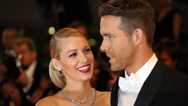 """Actor Ryan Reynolds and his wife actress Blake Lively pose as they arrive for the screening of the film """"Captives"""" at the 67th edition of the Cannes Film Festival in Cannes, southern France, on May 16, 2014."""