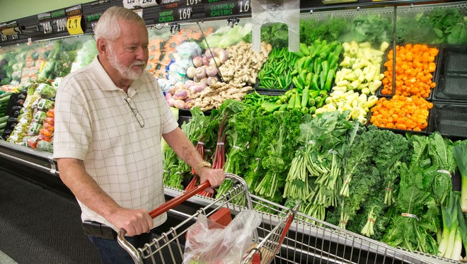 Wally Joslin shops at Phoenix grocery store. Five years after its controversial adoption, Phoenix's temporary tax on food expired at midnight on March 31.