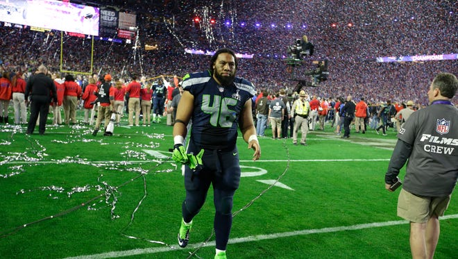 Seattle Seahawks fullback Will Tukuafu walks off the field after the second half of NFL Super Bowl XLIX football game Sunday, Feb. 1, 2015, in Glendale, Ariz.