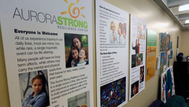 Posters adorn the wall of the Aurora Strong Resilience Center, a free counseling center opened in 2013 for local residents who have been affected by trauma, in Aurora, Colo. With theater shooting defendant James Holmes' trial startingApril 27, 2015, mental health counselors are preparing to help anyone coping with anxiety, flashbacks and other responses to reliving the Aurora theater shootings.