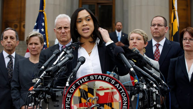 Marilyn Mosby, Baltimore state's attorney, speaks during a press conference where she announced criminal charges against all six officers suspended after Freddie Gray suffered a fatal spinal injury while in police custody.