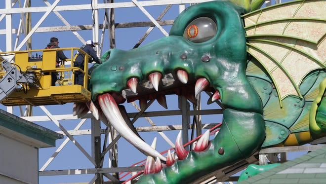 Workers repaint a section of the Dragon Coaster at Rye Playland on May 7, two days before the park's 2015 season begins.