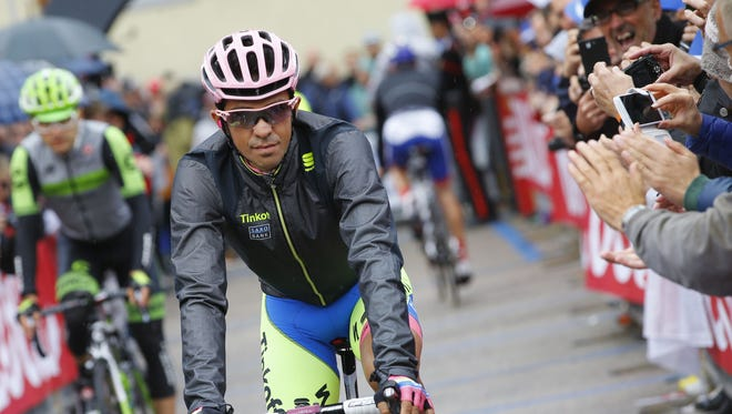 Spanish rider Alberto Contador (Tinkoff Saxo) rides to the start of the 16th stage of the 98th Giro d'Italia, Tour of Italy, cycling race between Pinzolo and Aprica on May 26, 2015 in Pinzolo.