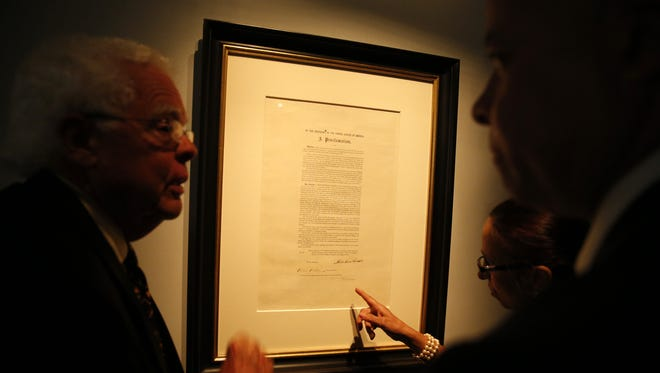 Cincinnati vice mayor David Mann, left, and City Manager Harry Black look at the Emancipation Proclamation document at The National Underground Freedom Center.