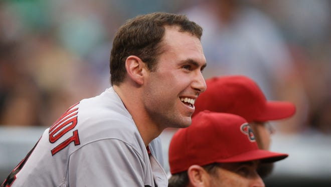 Arizona Diamondbacks first baseman Paul Goldschmidt loos on against the Colorado Rockies in the first inning of a baseball game Tuesday, June 23, 2015, in Denver.
