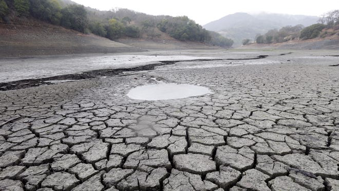 The cracked-dry bed of the Almaden Reservoir is seen on Feb. 7, 2014, in San Jose, Calif.