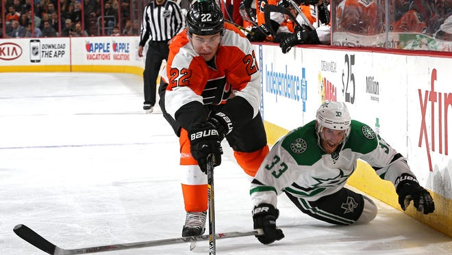 Flyers defenseman Luke Schenn (left) battles for the puck during a game against Dallas last season.